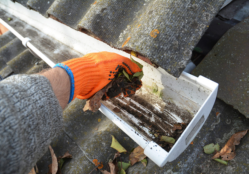 cleaner cleaning up gutter